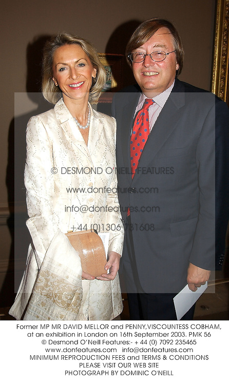Former MP MR DAVID MELLOR and PENNY,VISCOUNTESS COBHAM, at an exhibition in London on 16th September 2003.PMK 56