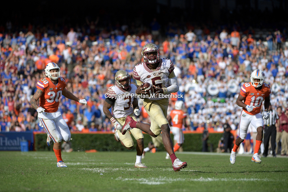 Florida State linebacker Matthew Thomas (6) runs after intercepting a pass intended for Florida tight end DeAndre Goolsby (30) during the second half of an NCAA college football game Saturday, Nov. 25, 2017, in Gainesville, Fla. FSU won 38-22. (Photo by Phelan M. Ebenhack)