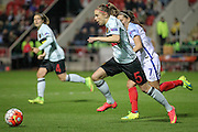 Lorca Van De Putte (Belgium) runs out of defence with the ball to clear the danger during the Euro 2017 qualifier between England Ladies and Belgium Ladies at the New York Stadium, Rotherham, England on 8 April 2016. Photo by Mark P Doherty.