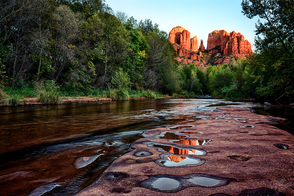 The last light of the day causes the red spires of Cathedral Rock to almost glow from within. I was able to find these little puddles near Oak Creek moments before the sun went below the horizon.