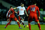 Bradley Johnson of Derby County (centre)  lines up a shot during the Sky Bet Championship match at the iPro Stadium, Derby<br /> Picture by Andy Kearns/Focus Images Ltd 0781 864 4264<br /> 24/02/2016