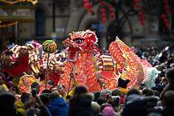 © Licensed to London News Pictures . 10/02/2019 . Manchester , UK . Dragons file through the crowd along Princess Street . People celebrate Chinese New Year in Manchester with a display of oriental culture and a procession through the city centre . Photo credit : Joel Goodman/LNP