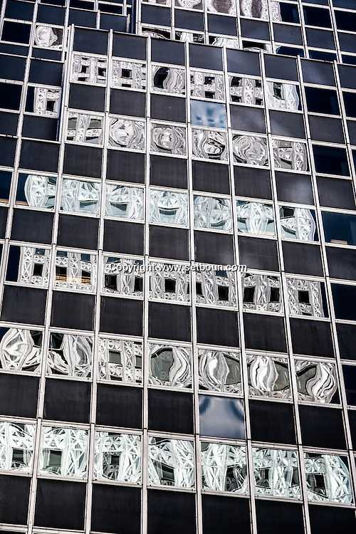New York, Mobil building  , reflection on a building on 42nd street and lexington  New York - United states