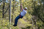 Bill Stec ziplines at The Ridges on Parents Weekend. Photo by Hannah Ruhoff