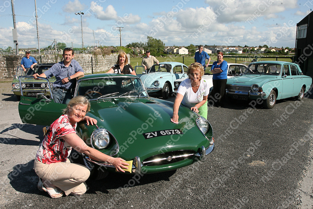 Francis Shannahan - '69 Cortina 1600E, Kevin Downes -'71VW, Kieran Fox -'76 MarkII Escort, Karen Shannahan -'67 Ford Corsair, Liam Horrigan - E Type Jaguar, Eileen Murphy - Clare Haven, Linda Drennan - Cystic Fibrisis Childrens Light of Hope and Kathleen Reese getting their cars ready for display on June 15th in the Ennis Showgrounds. <br />