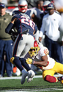 Washington Redskins wide receiver Jamison Crowder (80) tackles New England Patriots cornerback Logan Ryan (26) after Ryan intercepts a tipped pass that gives the Patriots a first down at the Washington Redskins 26 yard line during the 2015 week 9 regular season NFL football game against the New England Patriots on Sunday, Nov. 8, 2015 in Foxborough, Mass. The Patriots won the game 27-10. (©Paul Anthony Spinelli)