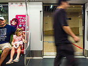 "27 DECEMBER 2015 - SINGAPORE, SINGAPORE: Passengers ride the expanded Downtown Line on the first day of service on the new line. Singapore opened the extension of the Downtown Line on its subway system Sunday. The extension is a part of Singapore's plans to make the city-state a ""car lite"" metropolis with plans to double the current subway to more than 360 kilometers of track by 2030. The government plans to have 80% of homes within a 10 minute walk of a subway station.    PHOTO BY JACK KURTZ"