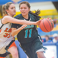 Piñon Eagle Brittany Begay (11) pushes past Patagonia Lobo Christina Novack (31) Friday at Prescott High School.