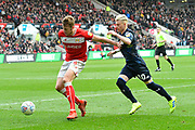 Ezgjan Alioski (10) of Leeds United battles for possession with Adam Webster (4) of Bristol City during the EFL Sky Bet Championship match between Bristol City and Leeds United at Ashton Gate, Bristol, England on 9 March 2019.