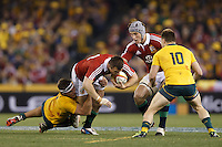 MELBOURNE, 29 JUNE - Tommy BOWE of the Lions is tackle by Michael HOOPER of the Wallabies during the Second Test match between the Australian Wallabies and the British & Irish Lions at Etihad Stadium on 29 June 2013 in Melbourne, Australia. (Photo Sydney Low / asteriskimages.com)