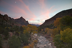 A colorful sunset over the Virgin river during fall at the bridge in Zion National Park, Utah.