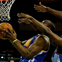Mar 18, 2013; New Orleans, LA, USA; Golden State Warriors power forward Carl Landry (7) is fouled by New Orleans Hornets shooting guard Terrel Harris (12) during the second half of a game at the New Orleans Arena. The Warriors defeated the Hornets 93-72.  Mandatory Credit: Derick E. Hingle-USA TODAY Sports