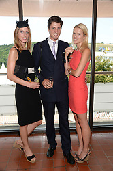 Left to right, SUSANNA WARREN, her brother JAKE WARREN and ZOE STEWART at the 3rd day of the 2013 Glorious Goodwood racing festival - Ladies day at Goodwood Racecourse, West Sussex on 1st August 2013.