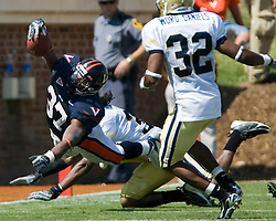 Virginia running back Cedric Peerman (37) lunges for a first down on a third and three rush play.  The Virginia Cavaliers football team faced the Georgia Tech Yellow Jackets at Scott Stadium in Charlottesville, VA on September 22, 2007.