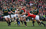 Jaque Fourie of the Springboks is tackled by Martyn Williams and Steven Jones of the Lions. <br /> Rugby - 090704 - Springboks vs British&Irish Lions - Coca-Cola Park - Johannesburg - South Africa. The Lions won 28-9 but lost the series 2-1 to the Springboks.<br /> Photographer : Anton de Villiers / SASPA