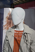 Background hair merges with a featureless shop mannequin in the window of a Marks & Spencer store in Walworth, on 2nd March 2017, in the London borough of Southwark, England.