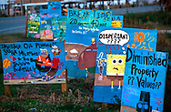 Hand-painted signs along Louisiana Highway 1 express Grand Isle residents' frustrations over the Deepwater Horizon BP oil spill Nov. 23, 2010. The barrier island, situated on the Gulf of Mexico at the southernmost tip of Louisiana, was heavily affected when the Deepwater Horizon oil rig exploded April 20, 2010, killing 11 workers and causing the largest offshore oil spill in United States history. (Photo by Carmen K. Sisson/Cloudybright)