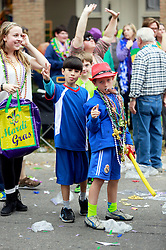 15 Feb 2015. New Orleans, Louisiana.<br /> Mardi Gras. Ben and Jesse catching beads at The Krewe of Thoth.<br /> Photo; Charlie Varley/varleypix.com