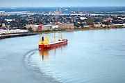 Cargo carrier navigates the famous crescent shaped riverbend on the Lower Mississippi River in New Orleans toward its way to the Gulf of Mexico.
