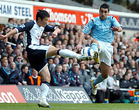 Photo: Ed Godden.<br />Tottenham Hotspur v Manchester City. The Barclays Premiership. 08/04/2006. Lee Young-Pyo (L) is challenged by Man City's Claudio Reyna.