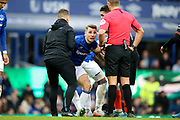 Everton defender Lucas Digne (12) gets helped to his feet but leaves the field injured during the Premier League match between Everton and Chelsea at Goodison Park, Liverpool, England on 7 December 2019.