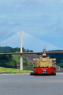 Ship crossing through Culebra Cut under the Centenial Bridge at the Panama Canal.<br /> Buque cruzando el Corte Culebra por el Puente Centenario en el Canal de Panama.