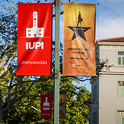 PUERTO RICO -- JANUARY  10, 2018: Banners announcing the dates for the award winning musical Hamilton hang of lamp posts on the campus of the University of Puerto Rico, on January 10 2018 in Rio Piedras, Puerto Rico.  The university's theater was the venue selected for the run of Hamilton but was replaced at the last minute due to security concerns.  <br /> (Angel Valentin / For The Times)