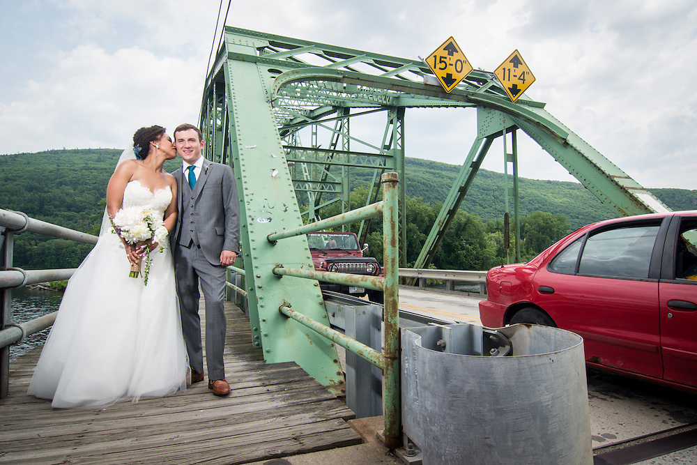 A bride and groom on the bridge over the Connecticut River in Brattleboro, VT.