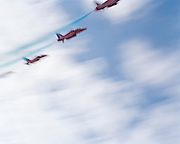 The Hawk jets of the 'Red Arrows', Britain's Royal Air Force aerobatic team make a low-level pass through summer skies. ,