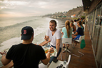 Lima, Peru- March 21, 2015: Friends enjoy drinks at Cala, a restaurant and bar along the coastline in Lima. CREDIT: Chris Carmichael for The New York Times