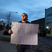 WASHINGTON, DC - MAR10: Robert Weiler Jr., 35, a fervent anti-abortion protester, looks towards the construction site of the new Planned Parenthood which is across the street from the Two Rivers Public Charter School, March 10, 2016, in Washington, DC. Weiler who has protested at the site is being sued by the Two Rivers school to stop him from protesting so close to the school.<br /> <br /> Weiler served five years in federal prison for planning to bomb another clinic. In 2006, authorities received information from Weiler&rsquo;s parents that they believed their son planned to destroy an abortion clinic. Weiler said he had intended to use a pipe bomb to blow up the abortion clinic in College Park. He also said he had planned tos hoot doctors who perform abortions. Since serving his prison sentence and probation, Weiler says he has protested at several places. (Photo by Evelyn Hockstein/For The Washington Post)