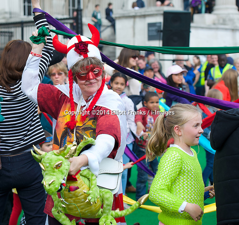 Feast of St. George celebrations. Atmosphere. Trafalgar Square, London, United Kingdom. Monday, 21st April 2014. Picture by Elliott Franks / i-Images