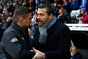 Fulham First Team Head Coach Slavisa Jokanovic and Barnsley manager Paul Heckingbottom shake hands before kick off during the EFL Sky Bet Championship match between Fulham and Barnsley at Craven Cottage, London, England on 23 December 2017. Photo by Andy Walter.
