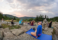 Kelli Powers and Laurel Brauns practice yoga during sunrise yoga class on the top of Piper Mountain with Kate Criscone from Body Design by Joy on Saturday morning.  (Karen Bobotas/for the Laconia Daily Sun)