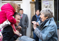 © Licensed to London News Pictures. 04/03/2019. Salisbury, UK. Prime Minister Theresa May greets shoppers as she visits Salisbury on the first anniversary of the poisoning of former Russian spy Sergei Skripal and his daughter Yulia in March 2018. They both survived the nerve agent attack but a resident of nearby Amesbury, Dawn Sturgess, died in June 2018 after coming in contact with the poison. Two Russians have been named in connection with the attack. Photo credit: Peter Macdiarmid/LNP