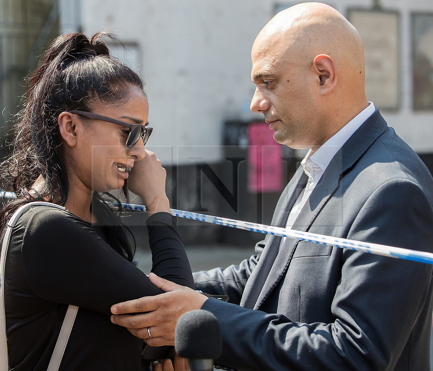 © Licensed to London News Pictures. 19/06/2017. London, UK. SAJID JAVID comforts a Muslim woman , who cries and tells him she is scared , at the scene . One man is known to be dead and several inured after a hired van was driven in to people on Whadcoat Street in Finsbury Park in North London after late night prayers at a nearby mosque . Photo credit: Joel Goodman/LNP