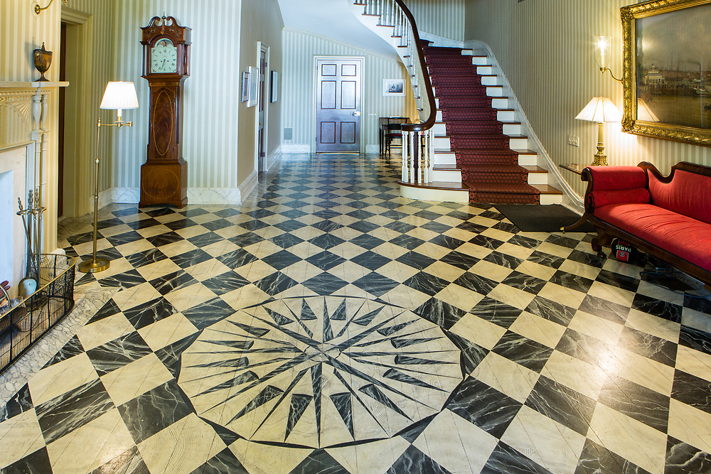 A compass rose and decorative painting on the floor of the foyer to Gracie Mansion.