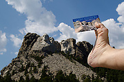 Footograph: Photograph of my right foot clutching a postcard at Mount Rushmore near Rapid City, South Dakota USA