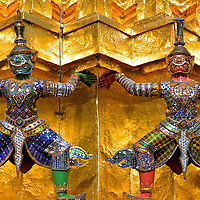 Close Up of Two Yakshas at Grand Palace in Bangkok, Thailand <br />