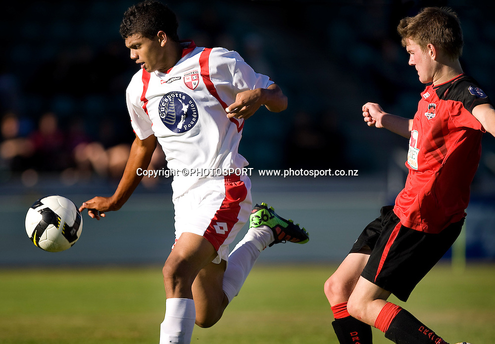Rafi Mohammidi runs with the ball with Canterbury United player Anthony Jones back in defence. Lion Foundation Youth League Final, Canterbury United v Waitakere United, English Park, Christchurch, Sunday 11 April 2010. Photo : Joseph Johnson/PHOTOSPORT