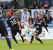 Dundee's Paul McGowan gets in a shot despite the attentions of Ross County's Jackson Irvine and Michael Gardyne - Ross County v Dundee, SPFL Premiership at the Global Energy Stadium, Dingwall<br /> <br />  - &copy; David Young - www.davidyoungphoto.co.uk - email: davidyoungphoto@gmail.com