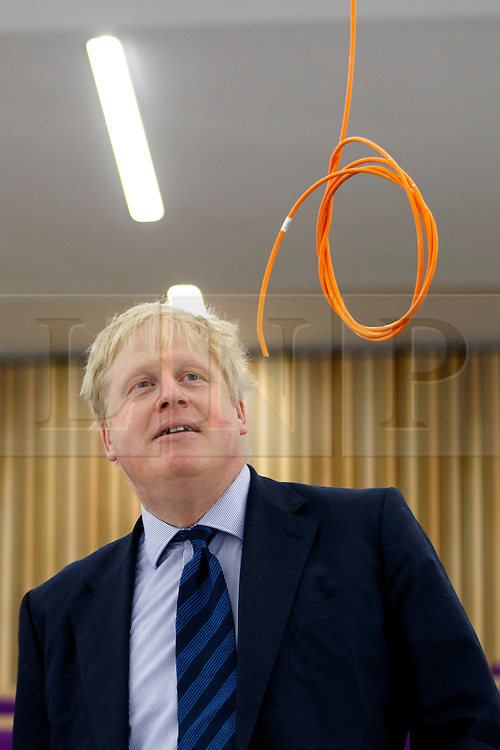 © Licensed to London News Pictures. 14/03/2016. London, UK. Mayor of London Boris Johnson looking a cable hanging down from a ceiling whilst visits Here East, the former press and broadcast centre in the Queen Elizabeth Olympic Park in London to kick start National Apprenticeship Week on Monday, 14 March 2016. Photo credit: Tolga Akmen/LNP