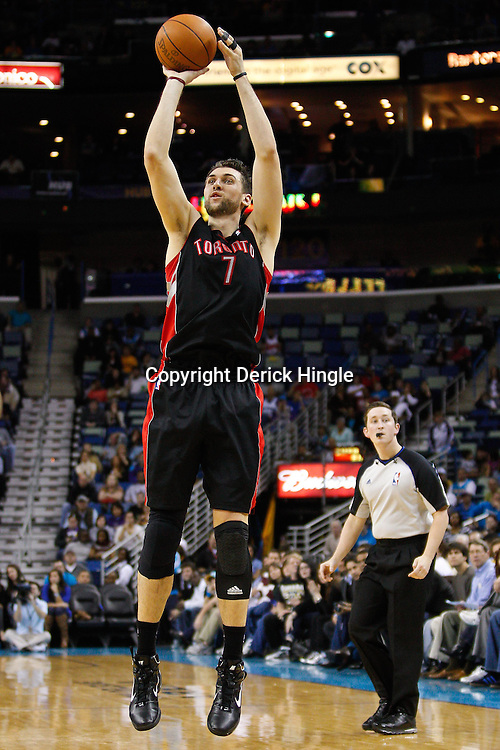 January 17, 2011; New Orleans, LA, USA; Toronto Raptors center Andrea Bargnani (7) shoots against the New Orleans Hornets during the fourth quarter at the New Orleans Arena. The Hornets defeated the Raptors 85-81.  Mandatory Credit: Derick E. Hingle