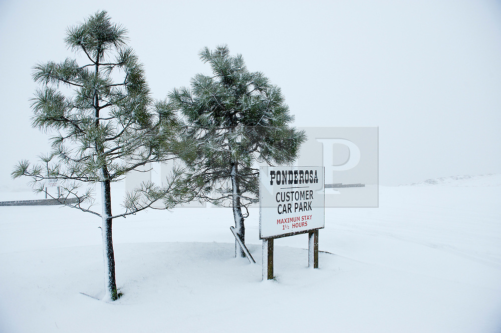 © Licensed to London News Pictures. 27/12/2014. Horseshoe Pass, Denbighshire, UK. The Ponderosa cafe at the pass is closed. Snow continues to fall on high ground in Wales.<br />   Photo credit: Graham M. Lawrence/LNP