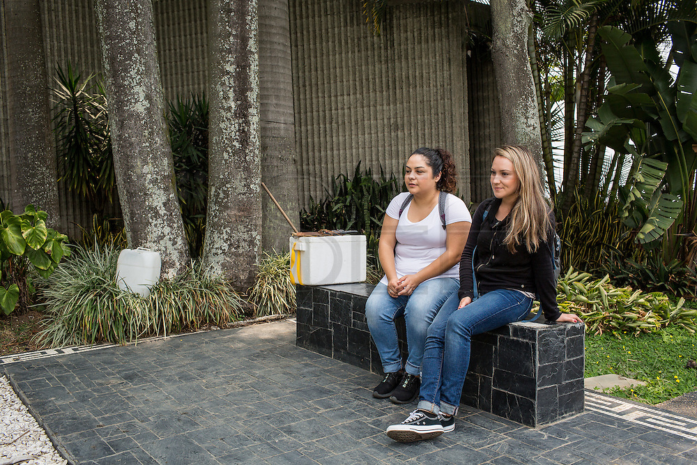 "30/03/2016 - Medellin: Colombia: Mexican tourists, Naib Tapia, 23, and Yanira Osuna, 23, visit the tomb of Pablo Escobar in Monte Sacro cemetery in Medellin. Tours focusing on the life and death of Pablo Escobar are becoming quite popular among international tourists that visit Medellín. In recent times more than 10 tour operators have started to give the tour, helped by the interest generated by Netflix ""Narcos"" series. (Eduardo Leal)"