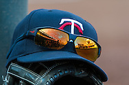 A close up view of a hat and sunglasses during a game between the Minnesota Twins and Detroit Tigers on April 3, 2013 at Target Field in Minneapolis, Minnesota.  The Twins defeated the Tigers 3 to 2.  Photo: Ben Krause