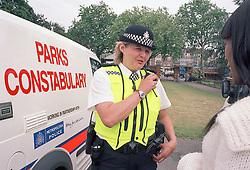 Parks Constabulary police officer & police dog van, Finsbury Park Haringey London UK