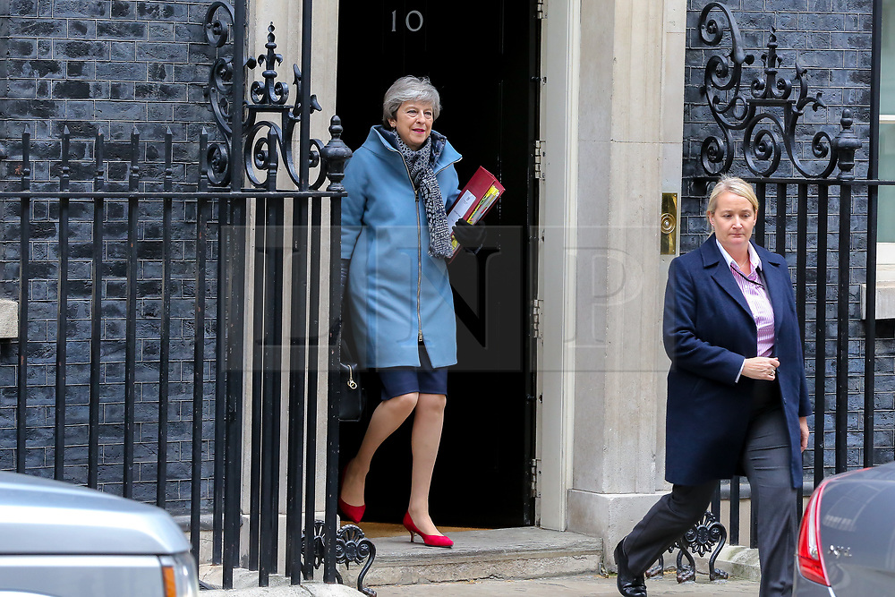 © Licensed to London News Pictures. 27/03/2019. London, UK. British Prime Minister Theresa May departs from Number 10 Downing Street to attend Prime Minister's Questions (PMQs) in the House of Commons. Later today the MPs will votes on series of indicative votes on alternatives to Prime Minister Theresa May's Brexit deal. Photo credit: Dinendra Haria/LNP