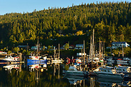Colorful boats moored in the Queen Charlotte City harbor, Haida Gwaii, British Columbia.