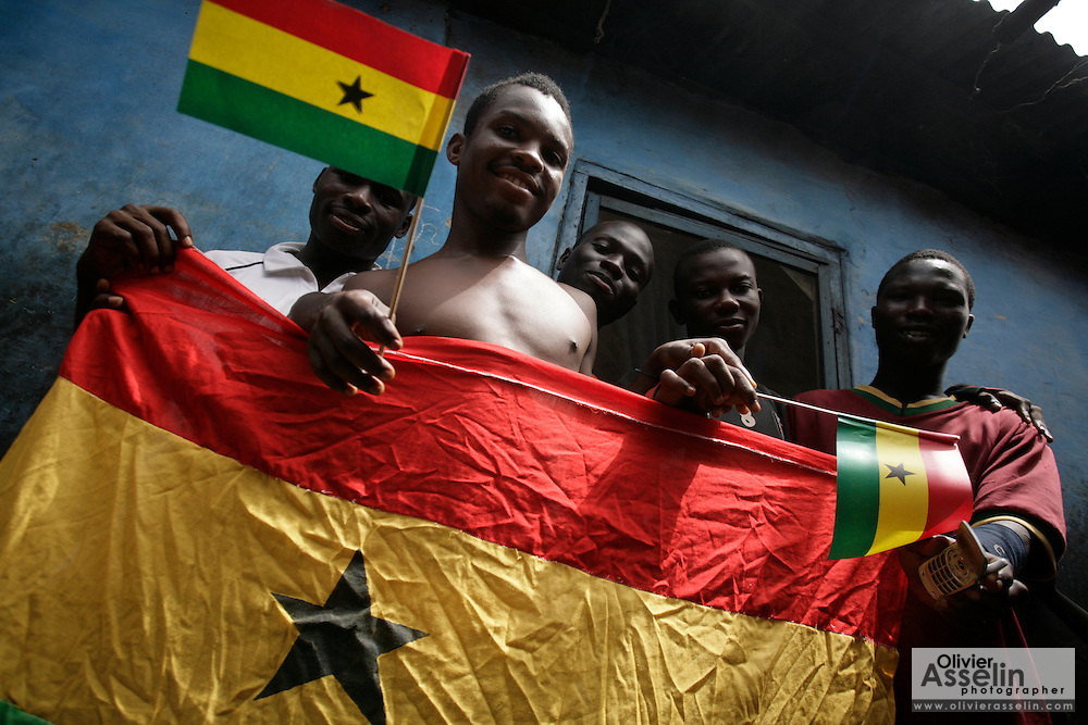 Young men holding Ghana flags in Accra, Ghana on the 50th anniversary of the country's independence from the UK.